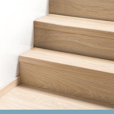Je trap bekleden met laminaat. Zelf doen of laten doen?