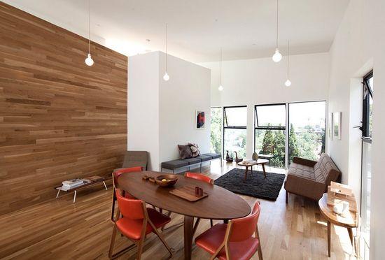 Interieurtip: Laat je laminaatvloer door lopen op de wand, voorbeeld woonkamer.