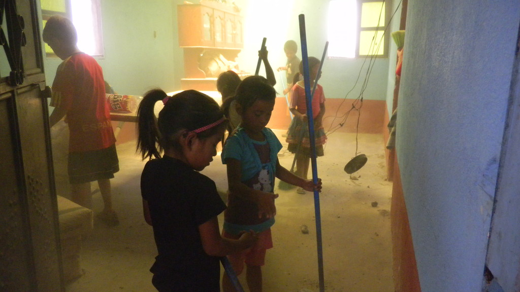 kids cleaning esbin's house after replacing the roof
