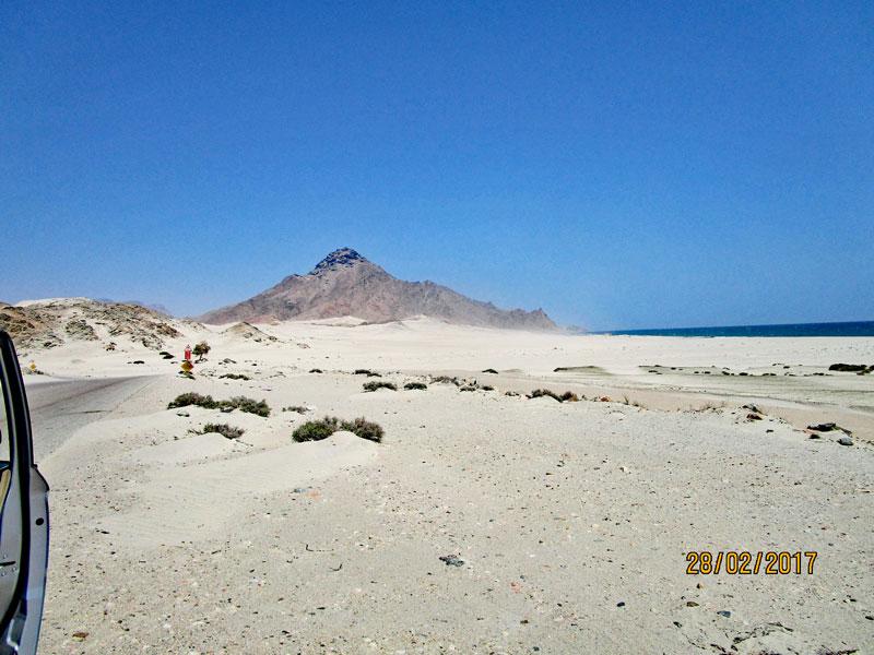 Bild 18 Blick auf den Sand und die dahinterliegende Küste