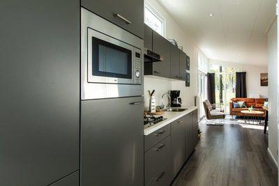 Te koop vakantiewoning voor 6 personen op de Veluwe inclusief kavel, tuinaanleg en inventaris keuken