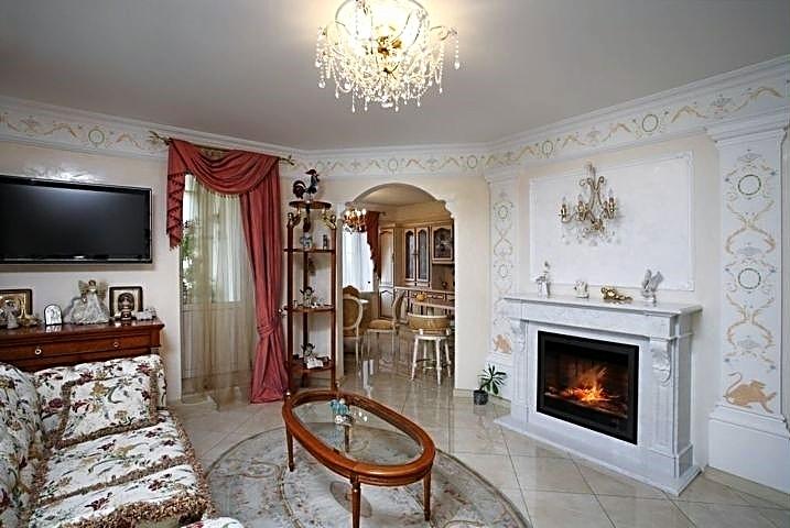 Фотография интерьера гостиной с видом интерьера кухни