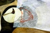 ⑥朱肉が付いた木に和紙をのせ、輪郭を写し取り、所定の位置に糊付けする。