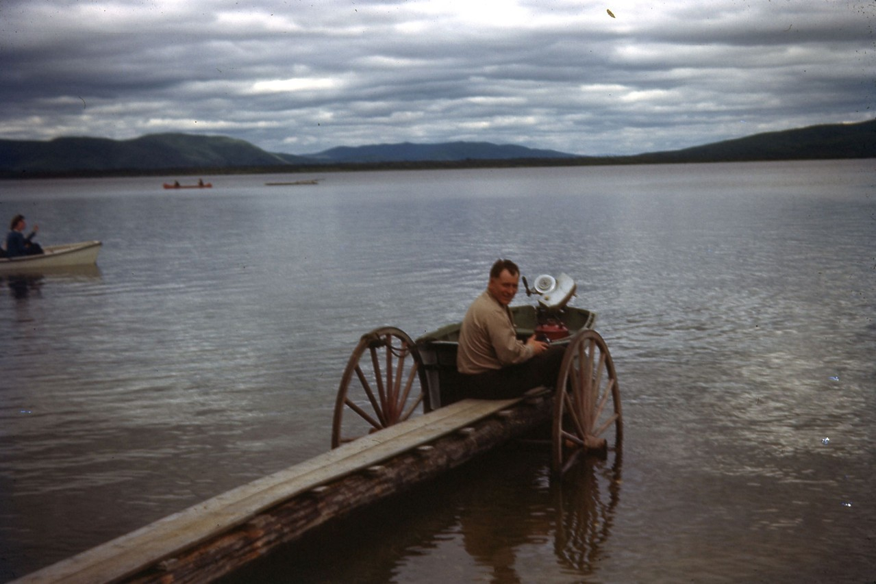 On dock, unknown man at Harding Lake in 1940's.  Looks like he had a good method to get the dock in and out of the lake.