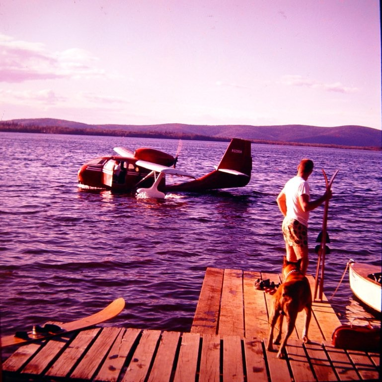 Unknown amphibious plane ans skier at Harding Lake. In the 1950's.
