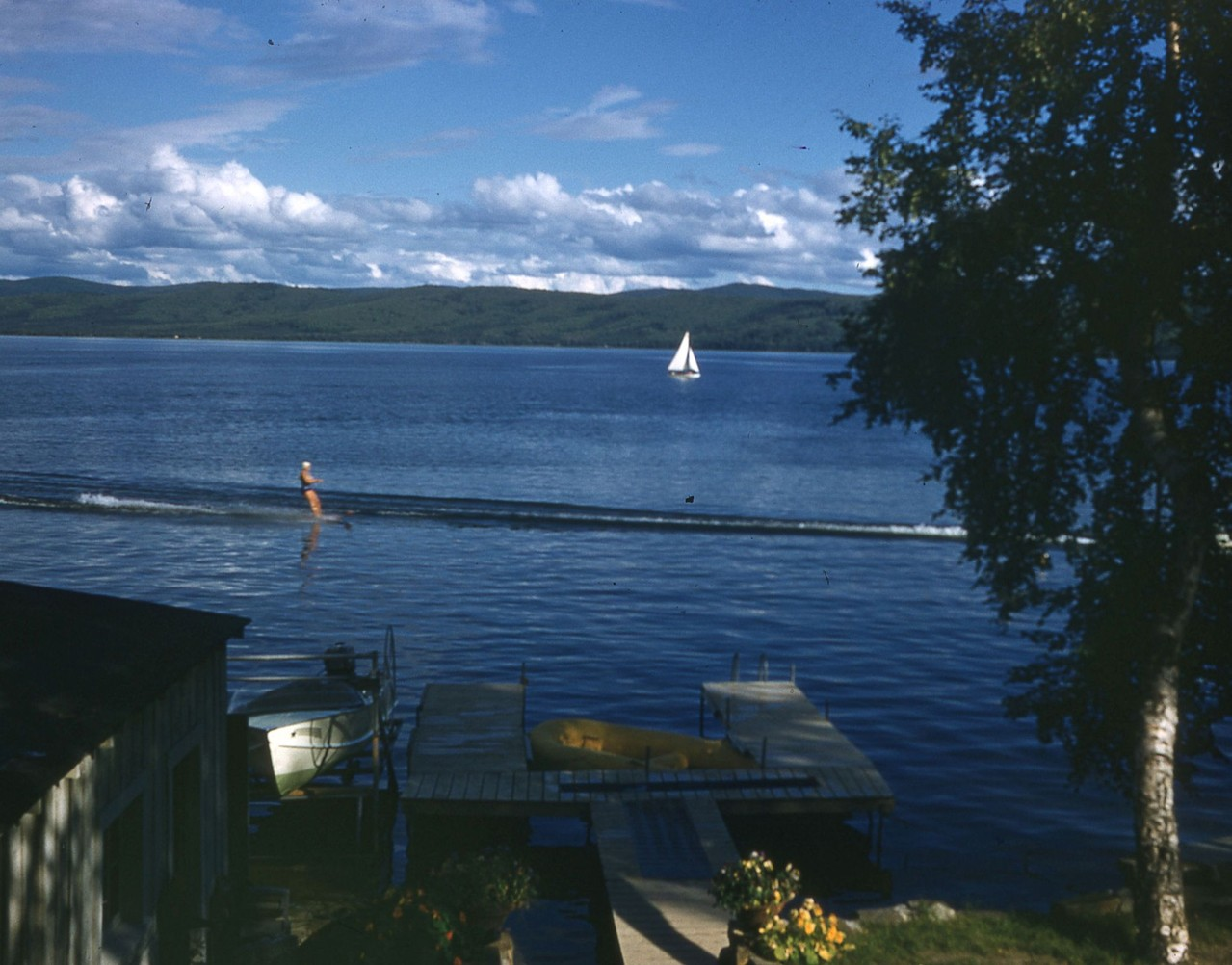 Sail boat and water skier taken in 1950's in front of Niewhoner cabin at 5th Street, Harding Lake.