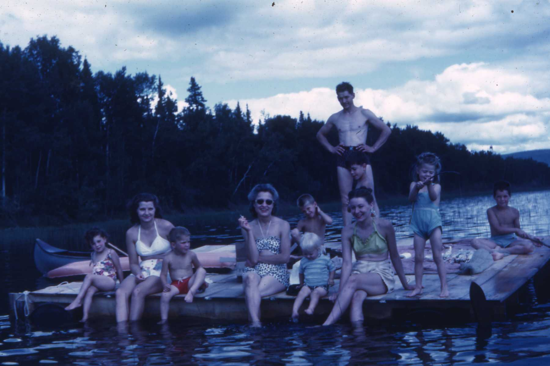 1946 with members of the Cook, Baggen and Clasby families.  Our mom is on the far left in the white swimming suit.  The younger lake generation will find it hard to believe there was no electricity and no phone service back then.  Electricity did not come