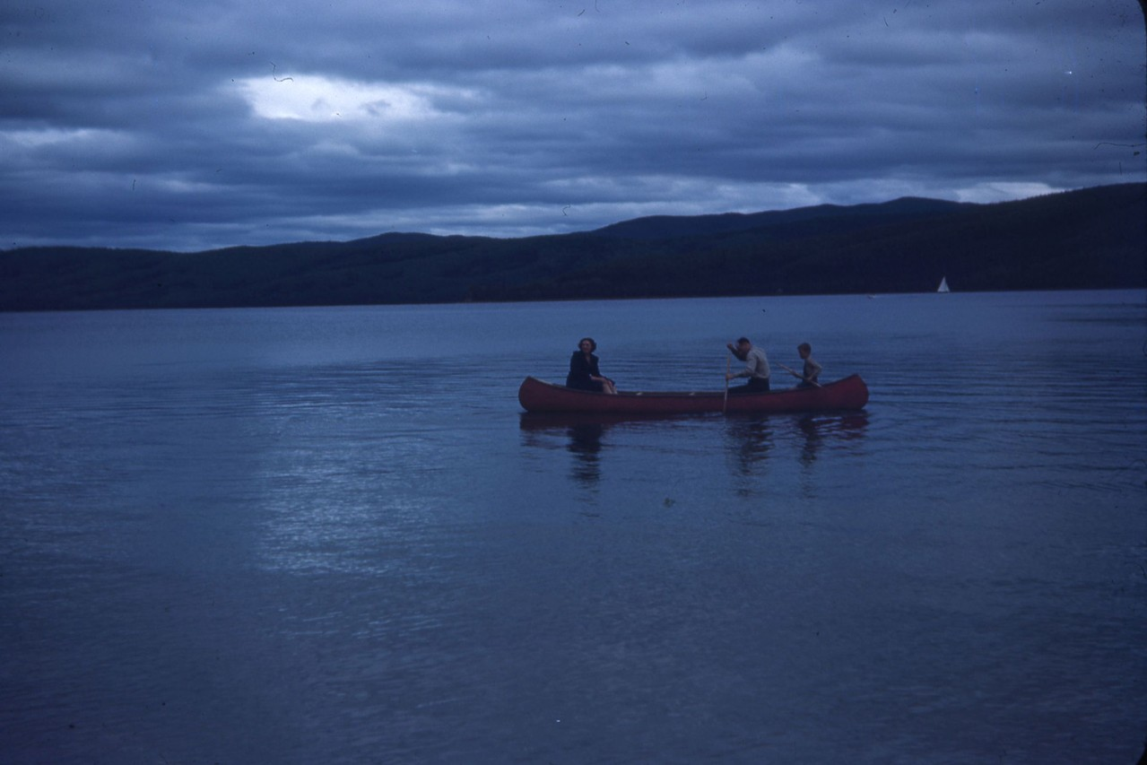 Unknown canoers at dusk. Harding Lake in 1940's.