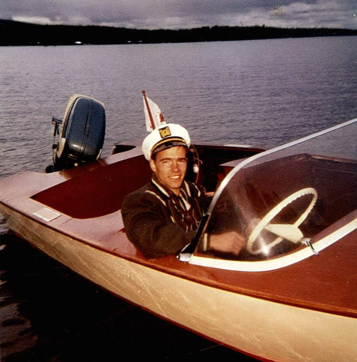 1959 Alan Richardson at Harding Lake in boat he built from a kit purchased through Sears.