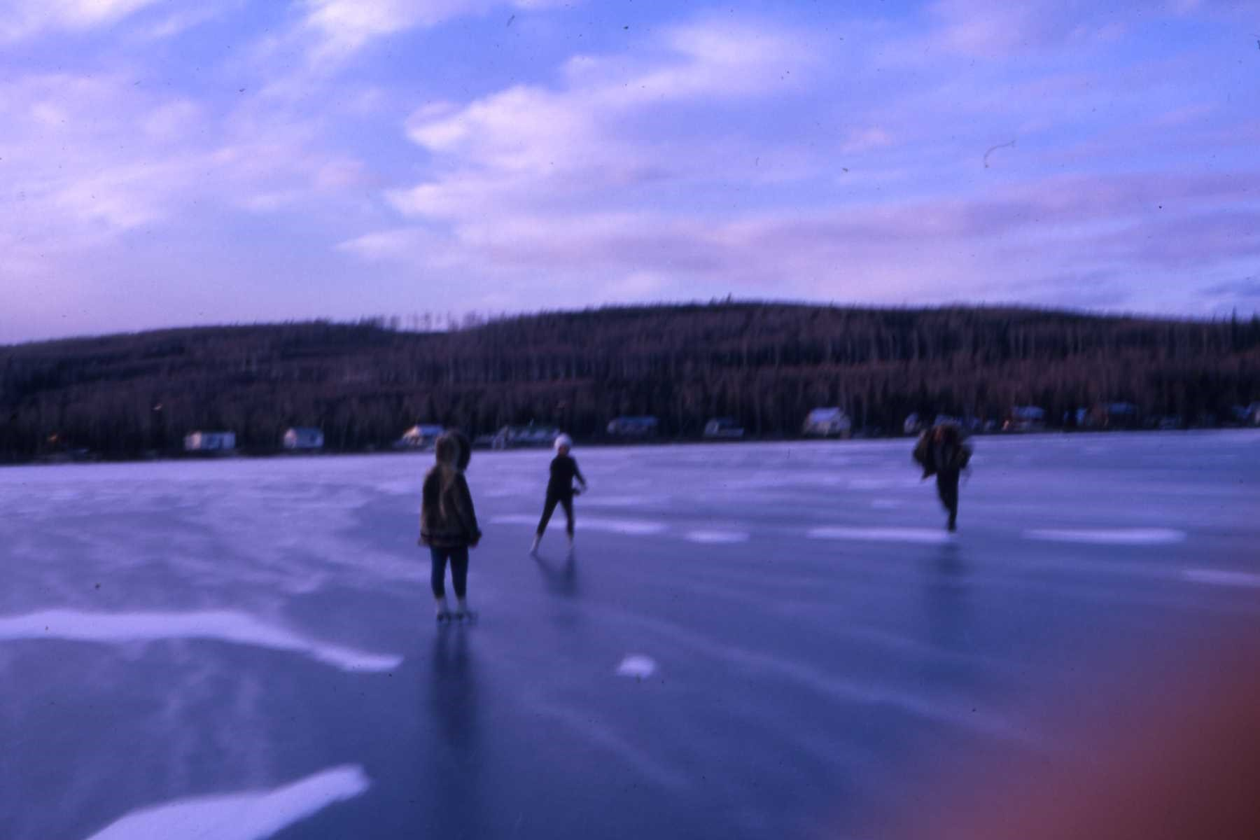Winter 1962 ice skating at the lake.  Hajdukovich cabin at middle of photo, a portion of which is still recognizable today