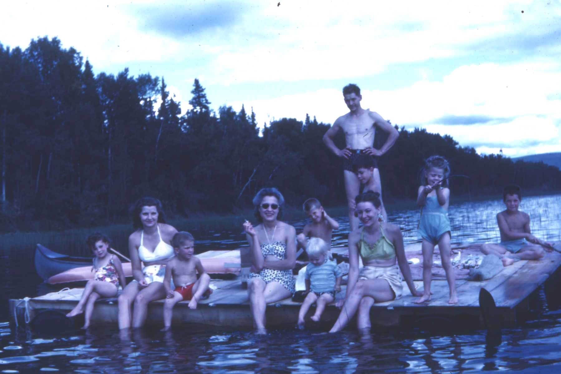 Left to Right:  Carolyn Clasby, Pat Cook, Jeff Cook, Hazel Clasby in sun glasses, Jill Baggen the blond child, Mike Cook behind Jill, Mertie Baggen, young Bob Clasby behind Mertie and in front of Earl Cook, Wendy Baggen and Skip Cook.  Taken around 1946.