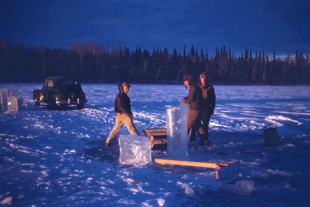 Unknown group harvesting ice for summer use at Harding Lake.  Probably 1940's based on the car in the photo.