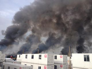 Calais jungle eviction, container camp, fire