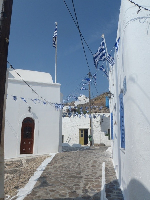 Plaka, Milos, Cyclades, Greece. flags