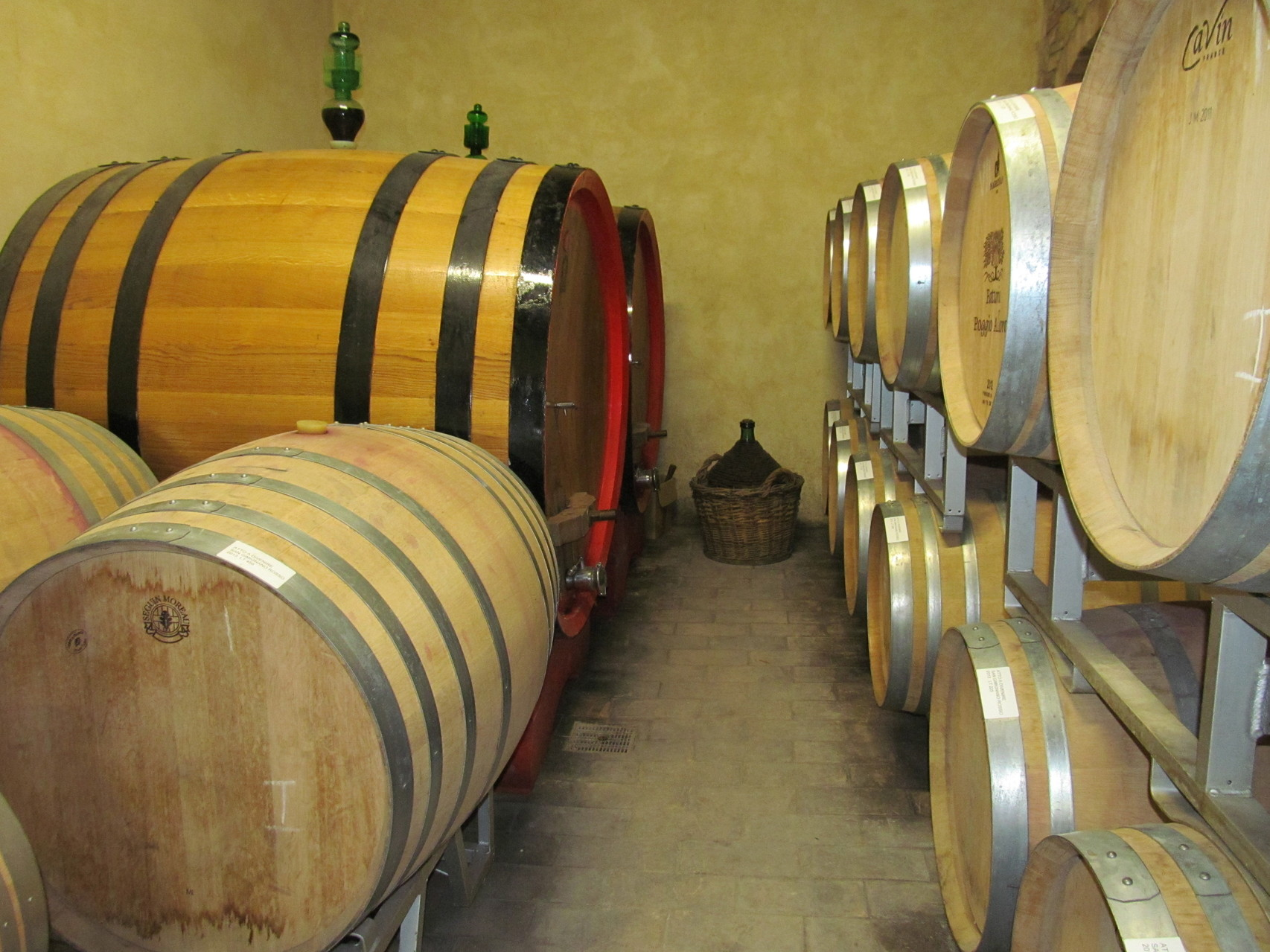 Old wine cellar with barrels for aging wine
