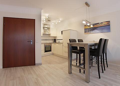 Der Küchenbereich, hell und modern.Die Küche ist mit allem Komfort ausgestattet.
