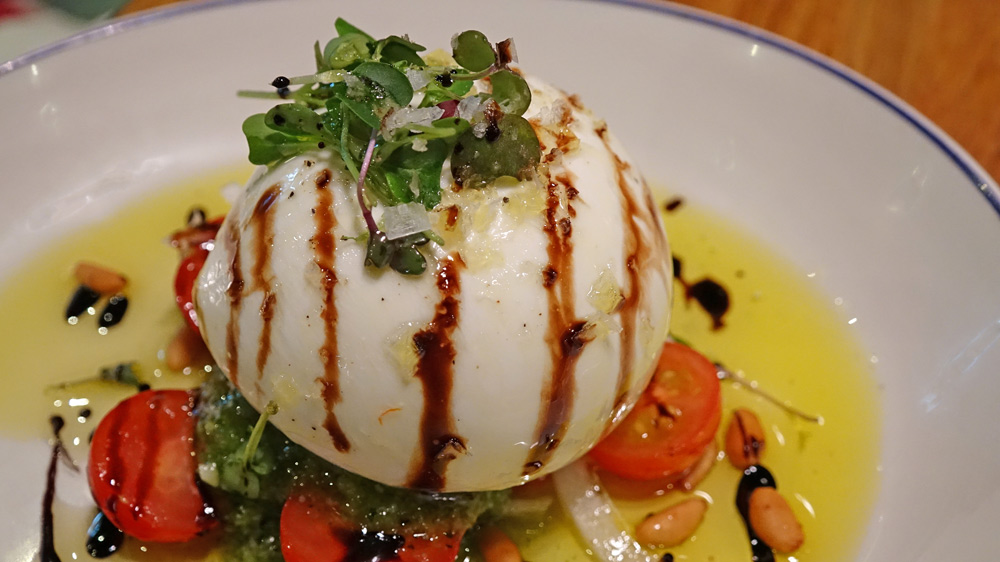Burratina with tomato and pesto
