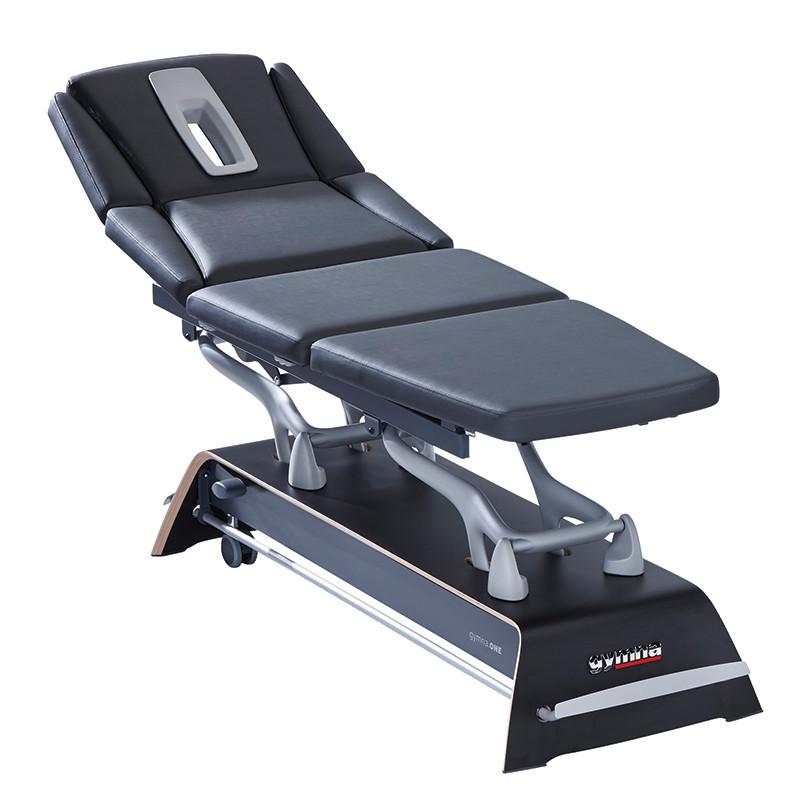 gymna.ONE - Q8 carbon black. Vierteilige, elektrisch höhenverstellbare Therapieliege inkl. Rundumschaltung, Polsterheizung und drei Motoren zur Einstellung der perfekten Behandlungsposition.