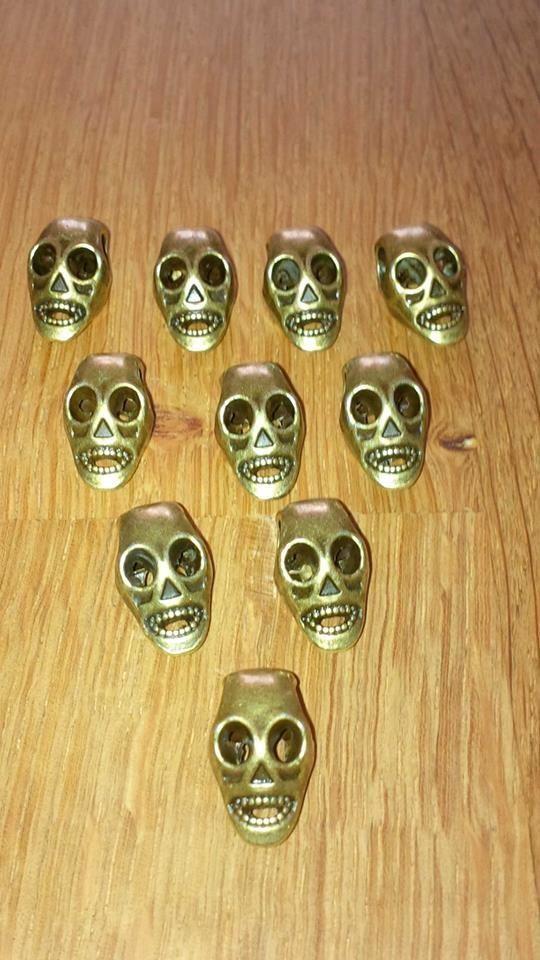 skulls bronce