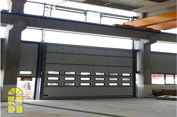 Mod le de portes de garages industrielles cie menuisiers for Garage ad bourgoin