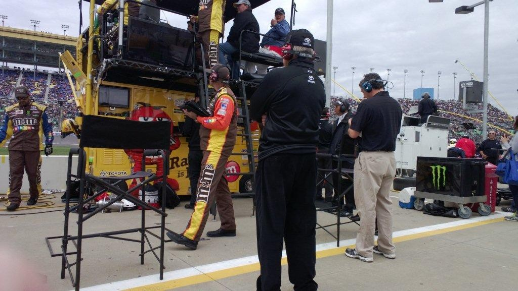 Sitting by Coach Gibbs in Kyle Busch's pit.