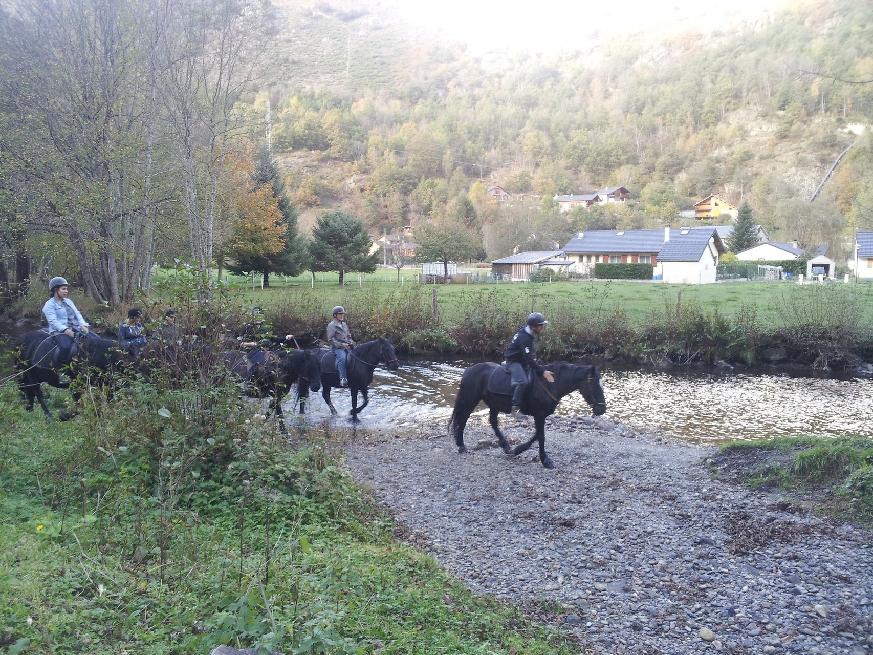 Balades à cheval passage dans l'eau