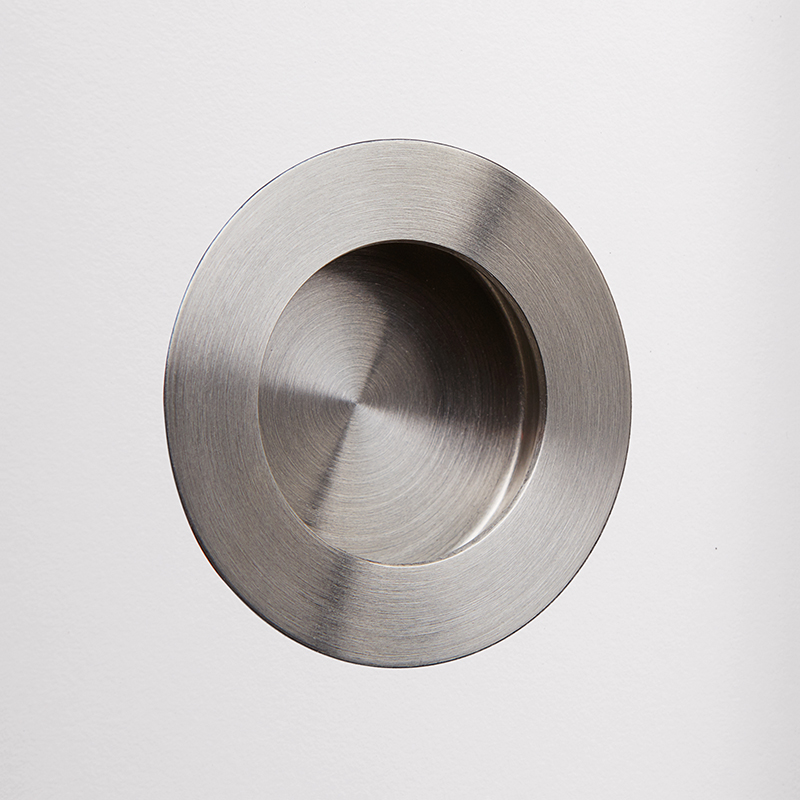 Recessed grip Ø 6.5 cm, brushed stainless steel.