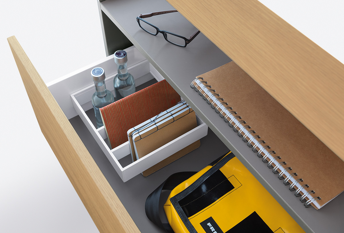 Drawer with dividing frame and free space for a handbag or files.