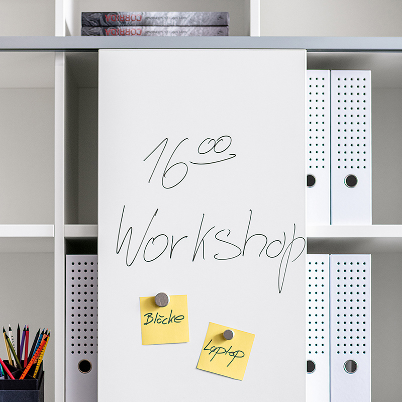 Sliding doors constructed with whiteboard material are magnetic and can be written on.