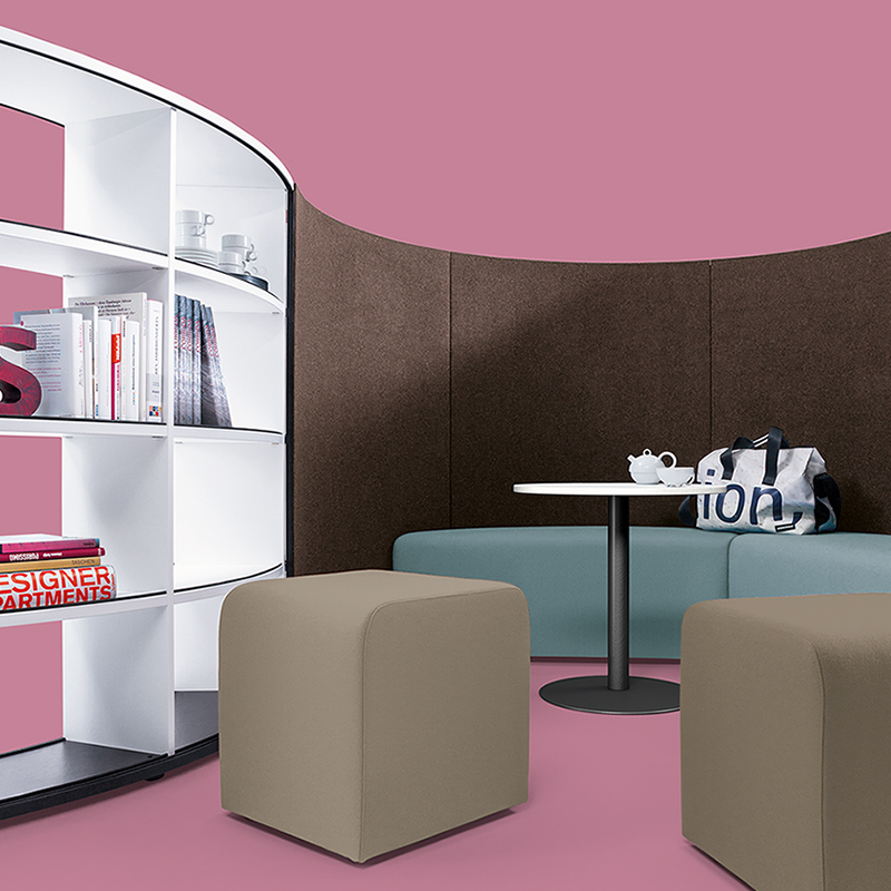 "The ""sit"" seating elements and the ""coffee table"" are designed to match the shelving system."