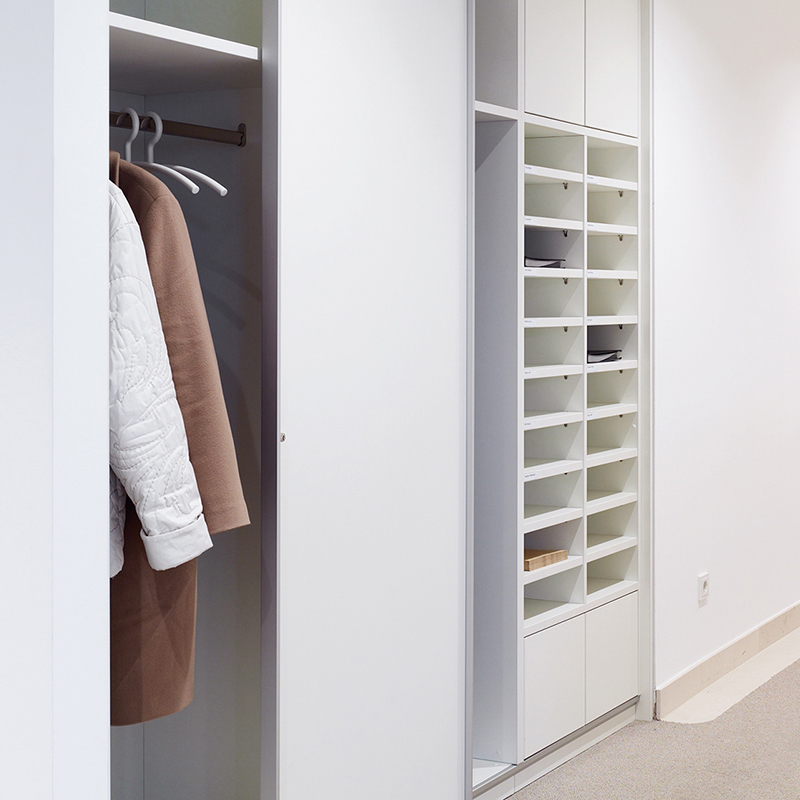 Wardrobe facilities and pigeonholes for mail are optional design features.