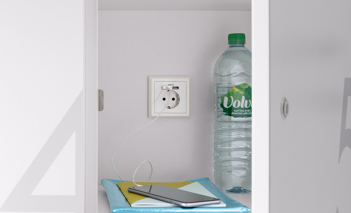 A socket with two USB chargers can be installed in the back panel of the locker as an option.