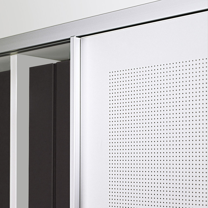 Large-format sliding doors made of acoustic material with micro-perforations are acoustically effective.