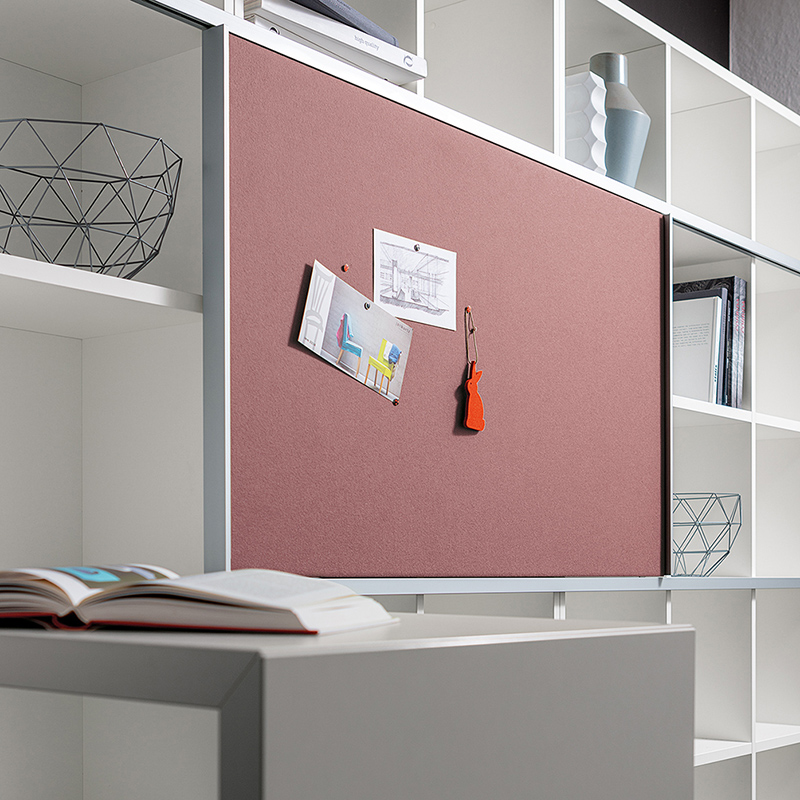 "Fabric-covered and pinnable sliding doors can be added to the ""basic S"" shelving system."