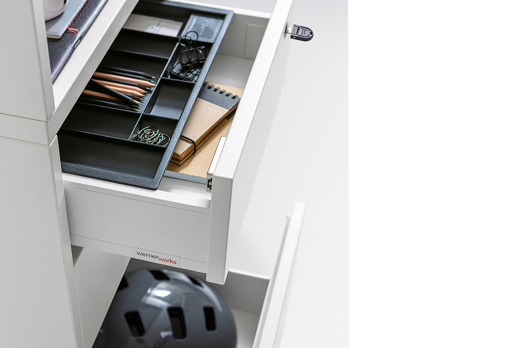 Drawers provide space for office supplies and private items.