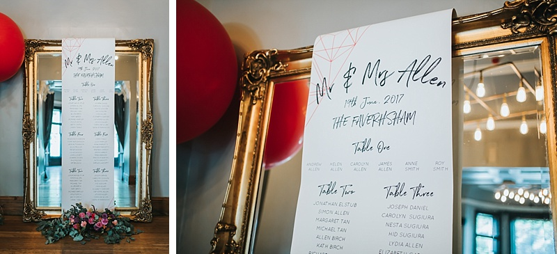 large gold gilt mirror with wedding table plan draped over