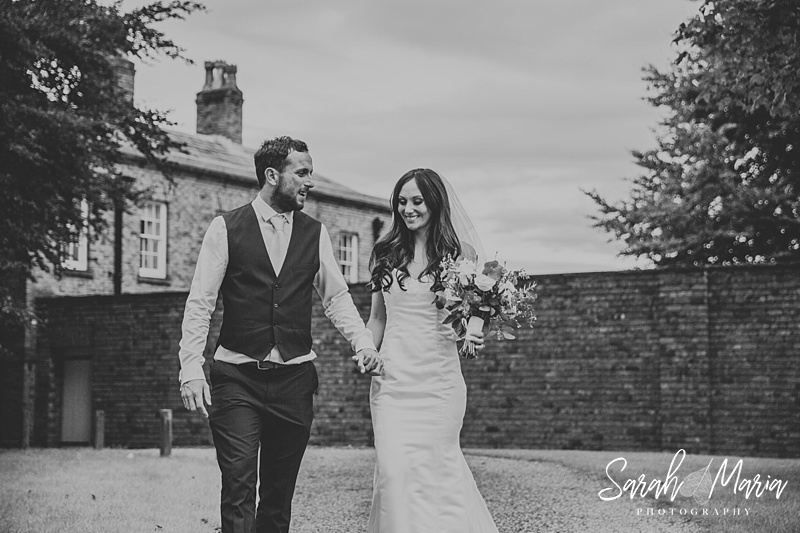 bride and groom portrait in front of meols hall wedding venue
