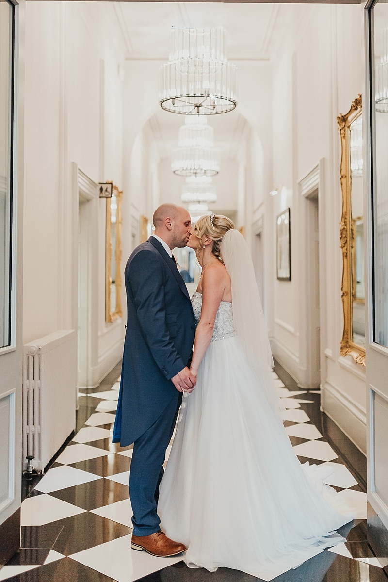 portrait of a bride and groom in the hallway of the principal York wedding venue