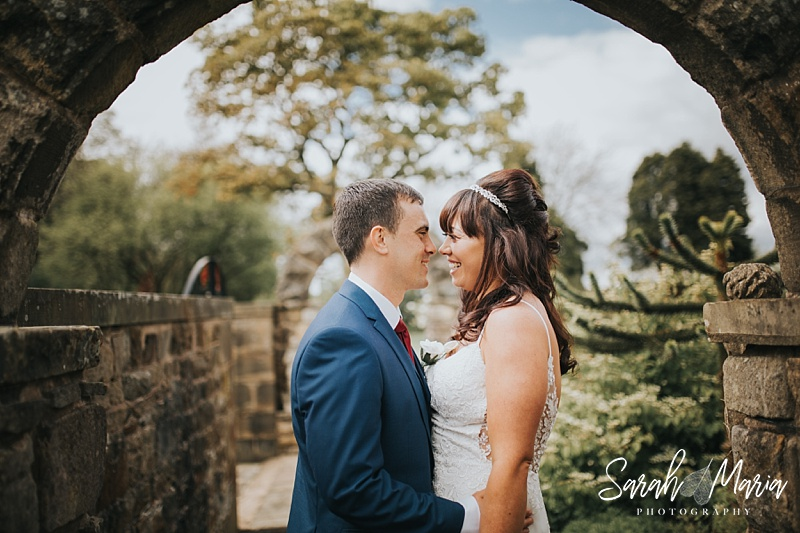 portrait of a bride and groom under the arch at Ferraris country house hotel
