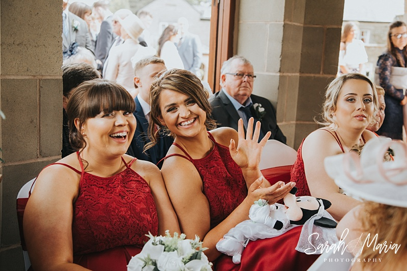 candid photograph of bridesmaids smiling