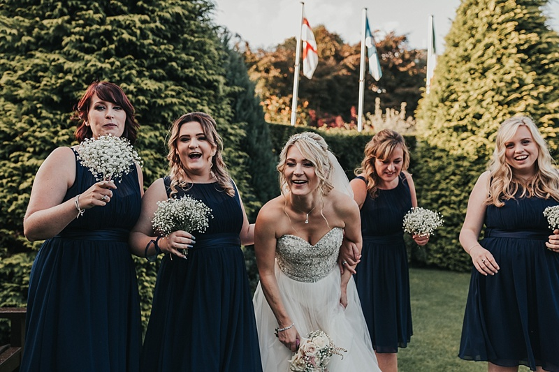 natural shot of a bride and her bridesmaids at a wedding at the principal York