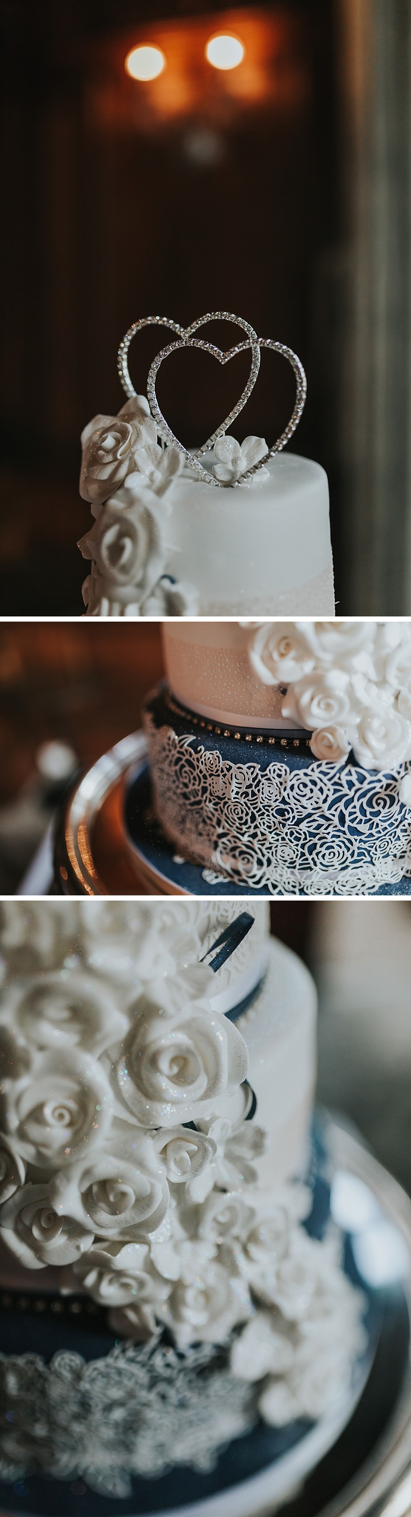 wedding cake details. Navy and white with a double heart topper