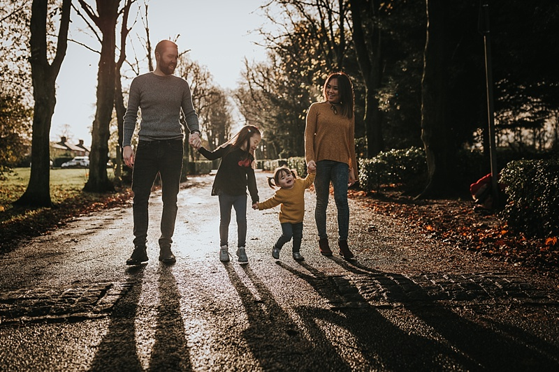 backlit family portrait during autumn