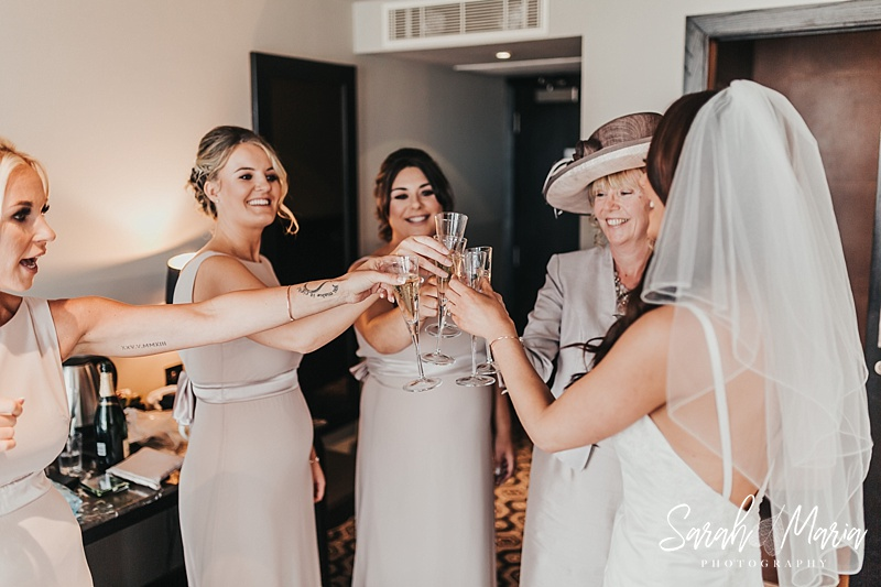 bridal party toasting to the bride being ready for her wedding day