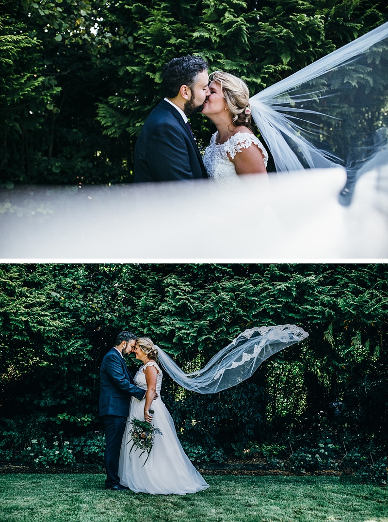 bride and groom portraits with the wind blowing her veil