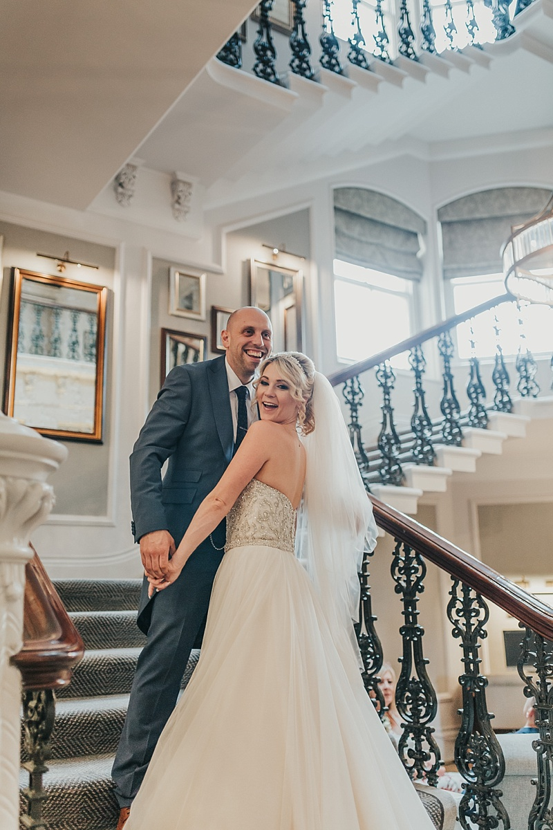 natural shot of bride and groom on the stairs of the principal York hotel