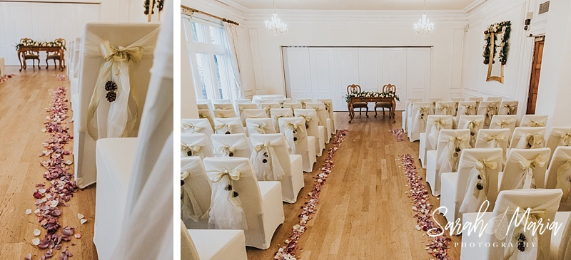 winter wedding ceremony room at west tower. flowers sprinkled on the aisle
