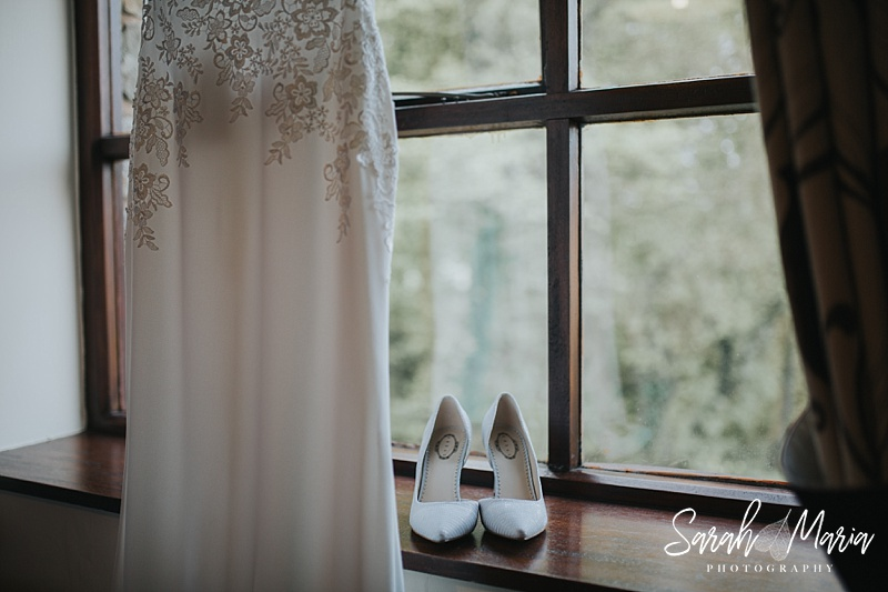 a detail shot of a wedding dress and bridal shoes