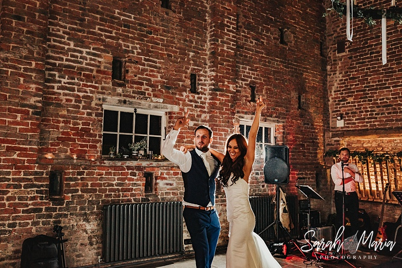 bride and groom dancing in the tithe barn