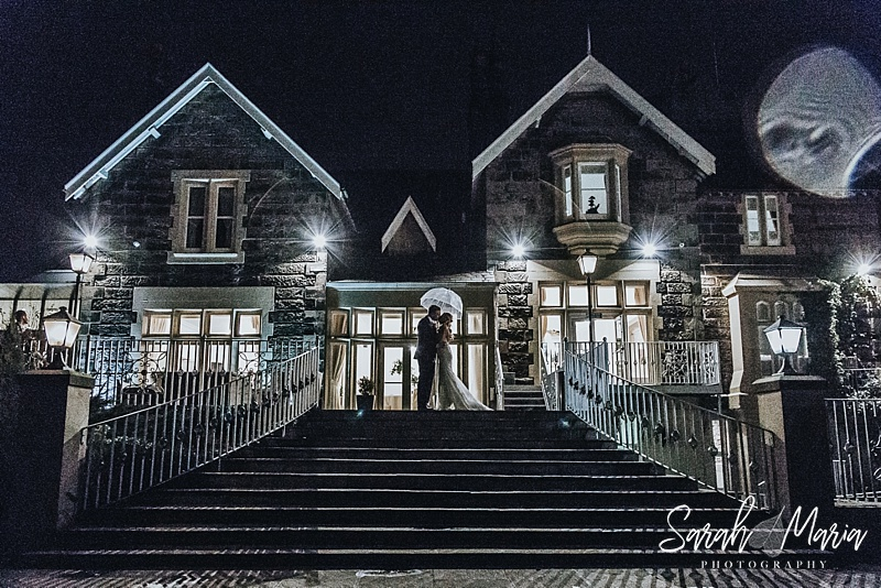 nighttime portrait of a bride and groom at west tower wedding venue